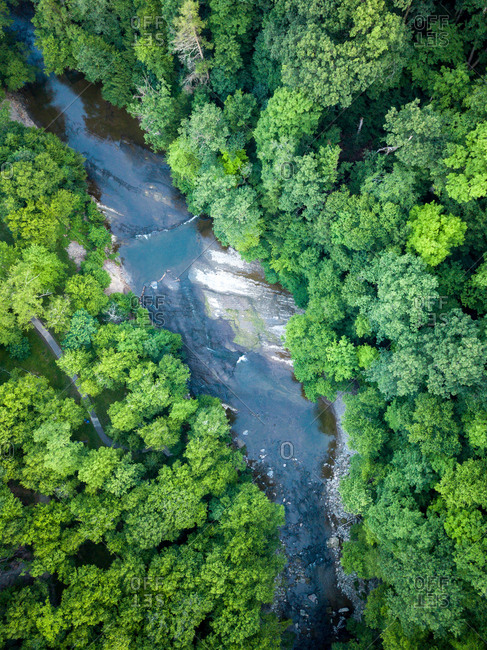Aerial view of the Chagrin river surrounded by trees in Bentleyville, Ohio, United States