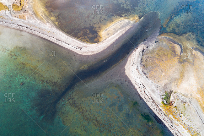 Abstract aerial view of the inlet of a small lagoon at the coast, Westfjords, Iceland