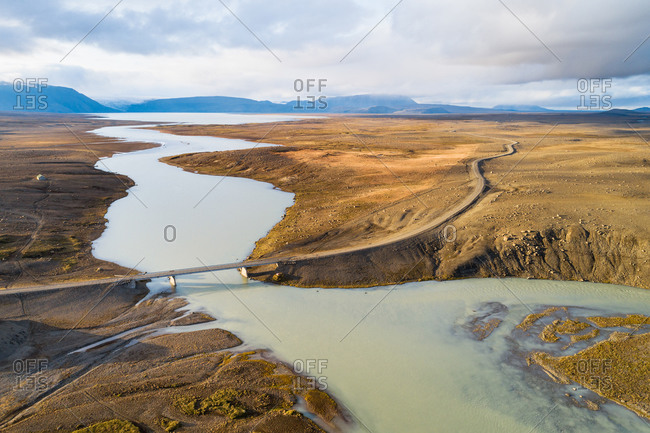 Aerial view of the Kjolur 4WD road through the highlands, with bridge over river Hvita and lake Hvitarvatn in the last sunlight of the day, Iceland