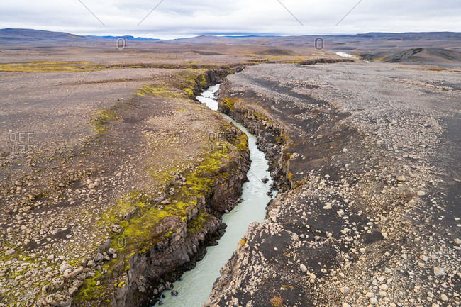 Aerial view of deep and winding river through the desolate and uninhabited Sprengisandur area in the highlands of Iceland
