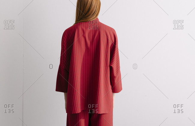 Back view of a model wearing a red striped designer suit