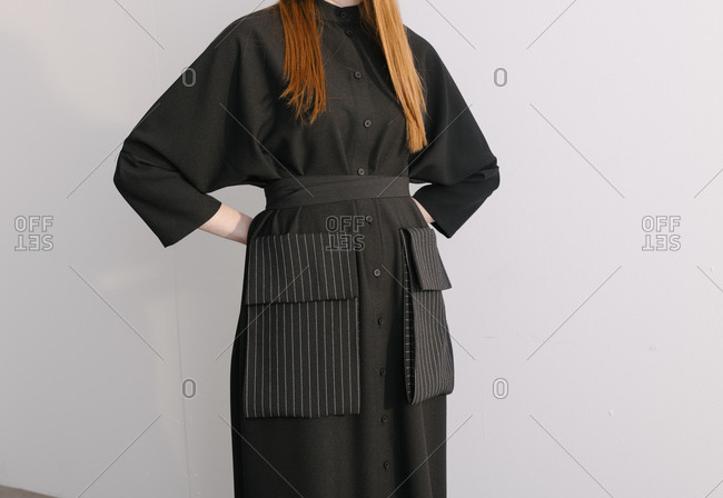 Stylish black designer outfit worn by model