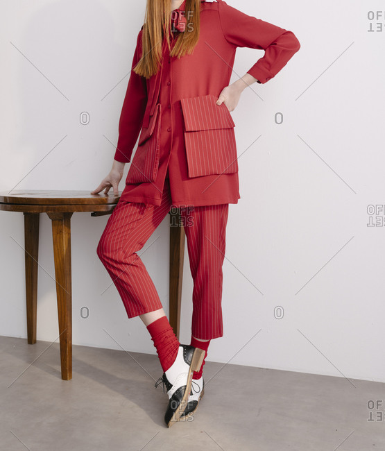 Fashionable woman dressed in a red designer suit