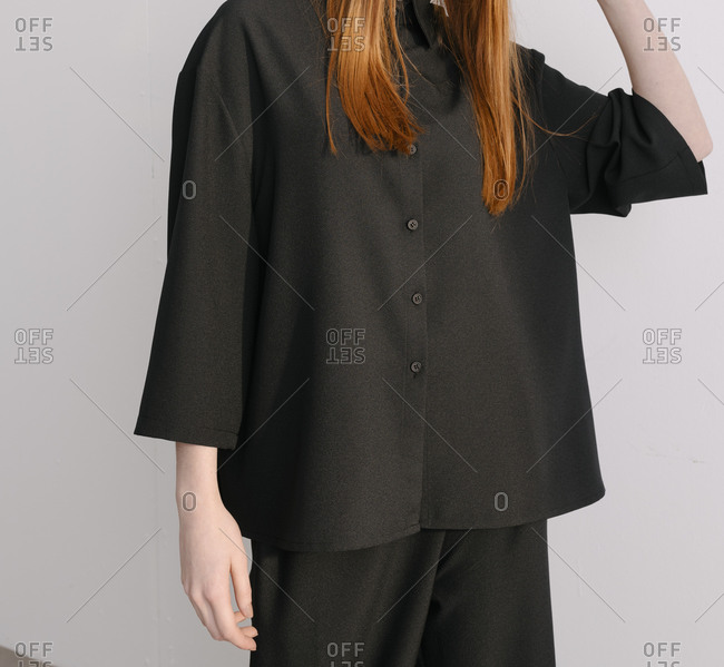 Young woman wearing black masculine designer outfit