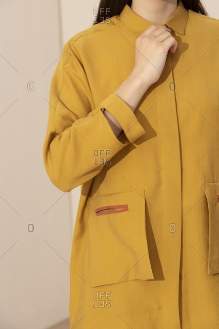 Model wearing stylish yellow jacket with large pockets