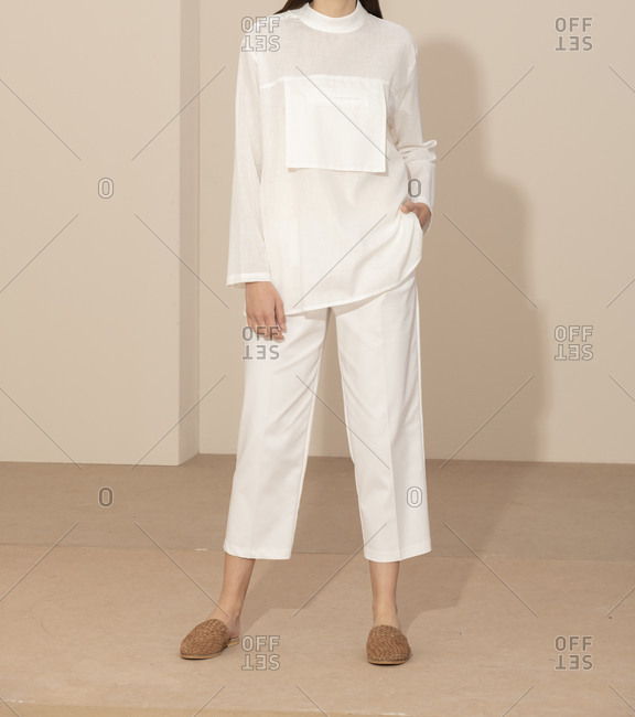 Studio shot of model wearing fashionable white outfit