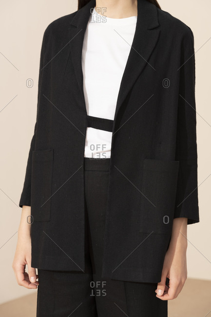 Woman wearing a stylish black suit with white top