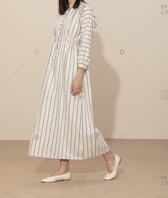 Model wearing a blue and white striped casual dress