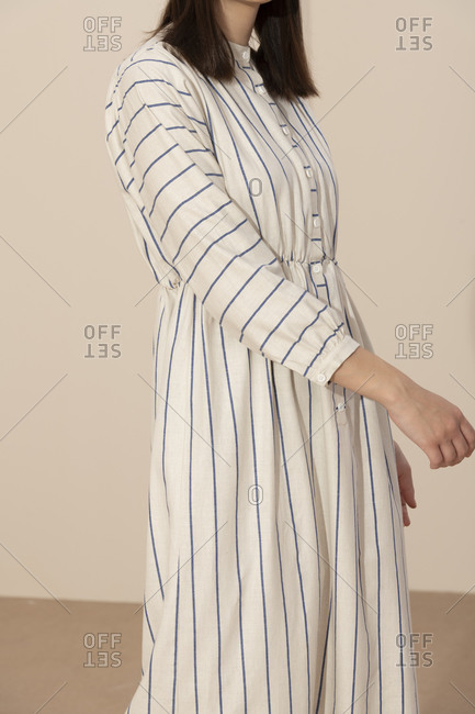 Close up of a model wearing a blue and white striped casual dress
