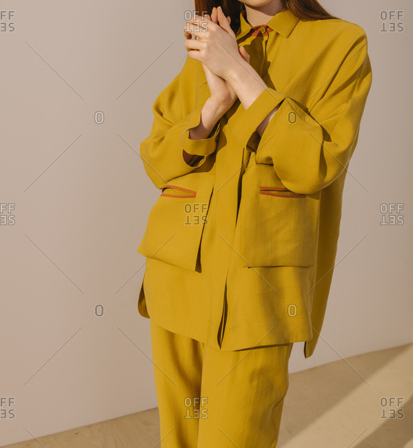 Model wearing a mustard yellow outfit