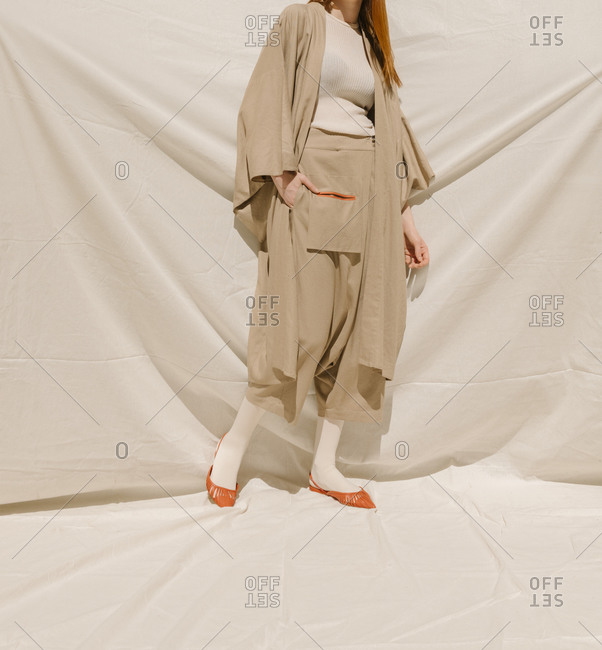 Young model wearing a tan drop-crotch style pant outfit
