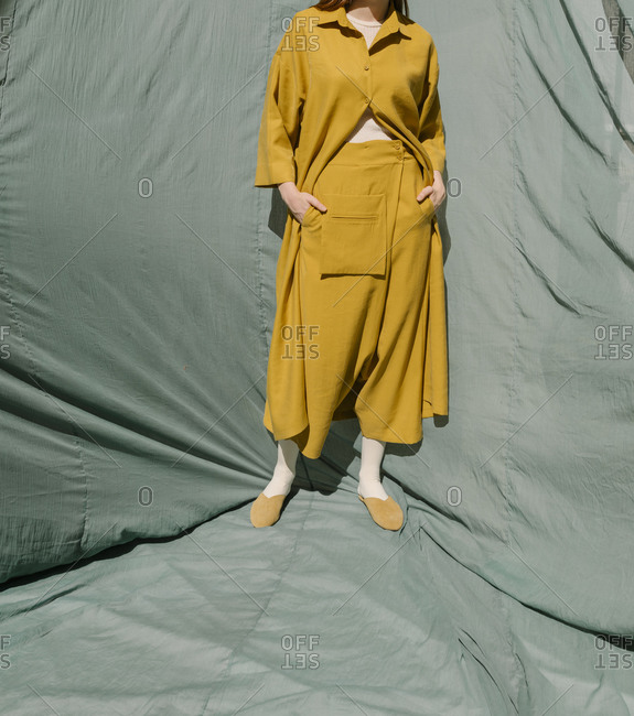 Woman wearing mustard yellow outfit with a drop-crotch and large pocket