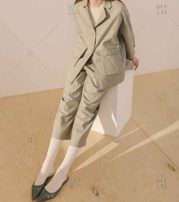 Model wearing a casual tan capri suit
