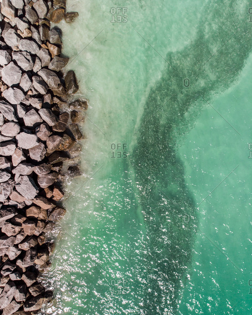 Aerial view of fishes swimming next to the pier of Miami Beach, FL, USA
