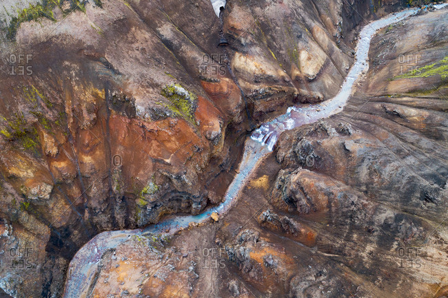 Aerial view of a stream through a canyon in the colorful Kerlingarfjoll mountains in the highlands of Iceland