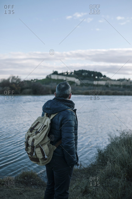 Caucasian young man looking at the horizon