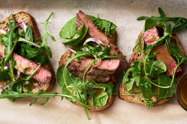 Top view shot of roast beef and arugula sandwiches