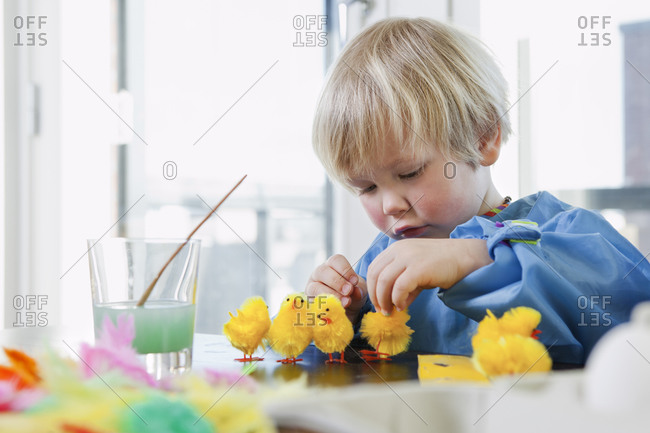 Boy decorating eggs for Easter