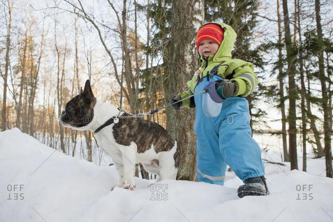Boy walking outside with dog