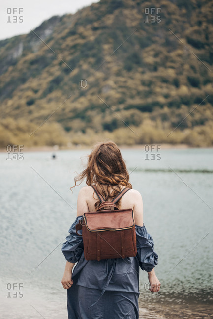 Ginger young woman traveling to the lake for a picnic