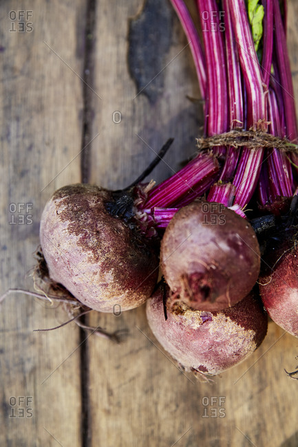 Close up of a bunch of beetroot on a wooden surface