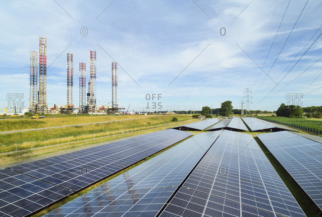 Large solar farms, disused oil rigs stored in Vlissingen harbor, Nieuwdorp, Zeeland, Netherlands