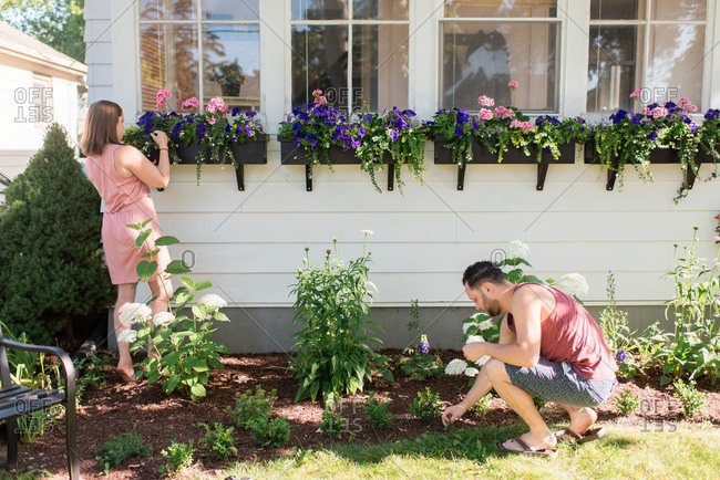 Couple gardening in front porch