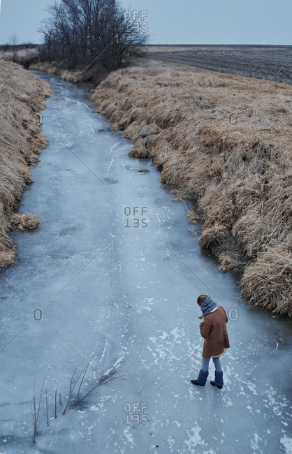 Person walking on frozen river, Champaign, Illinois, USA