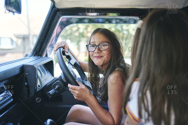 Young girls pretending to drive