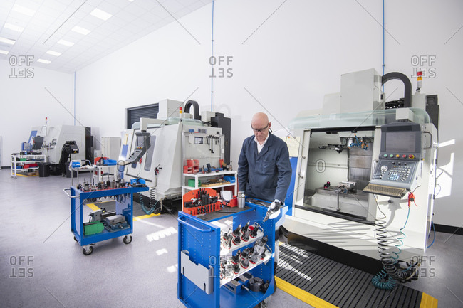 CNC lathes and operator in medical scientific factory