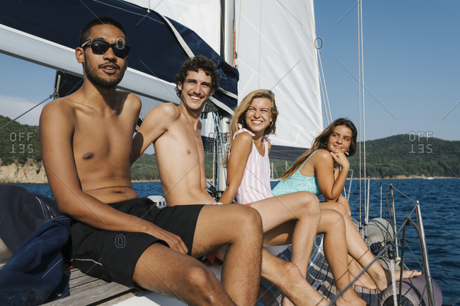 Friends relaxing on sailboat, Italy