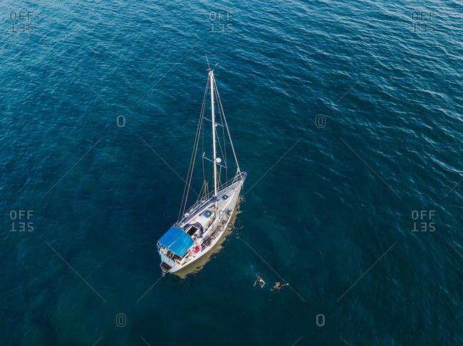 Sailboat afloat on sea, Italy