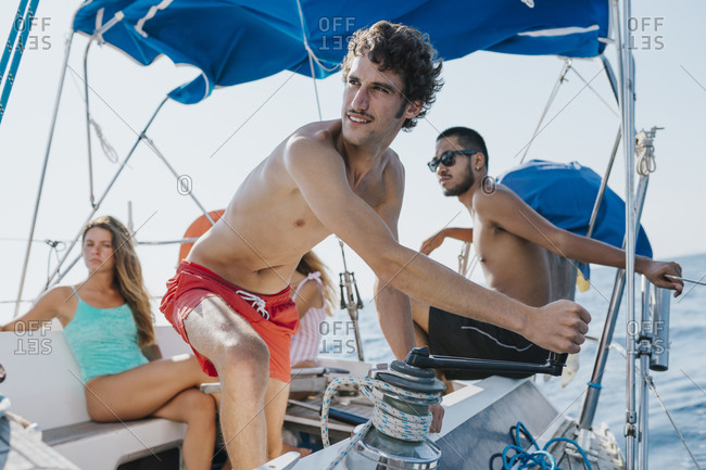 Friends on sailing holiday, Italy