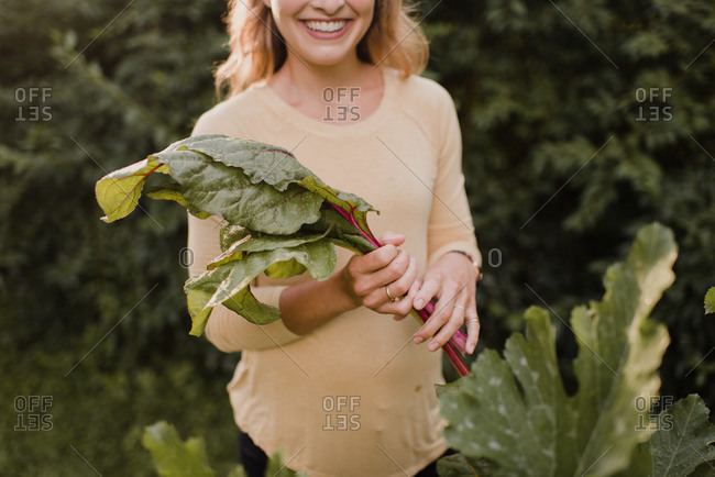 Woman gardener with fresh produce from garden