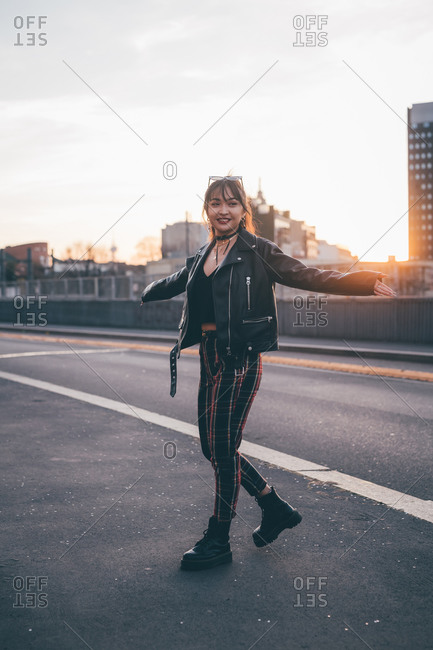 Young woman in punk style posing in street, Milan, Italy