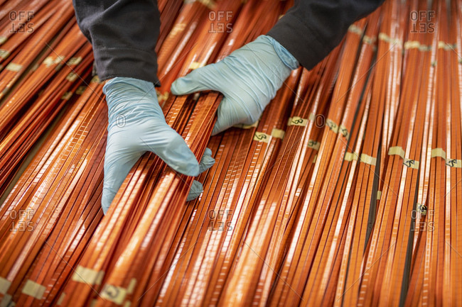 Close up of electrical engineer inspecting copper windings in electrical engineering factory
