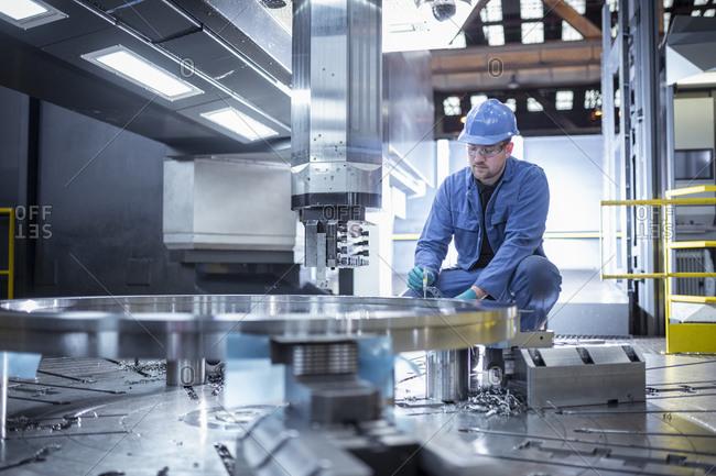 Specialist lathe operator in steelworks
