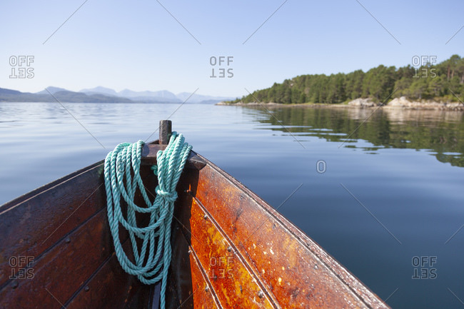 Bow of boat sailing in lake, Finland