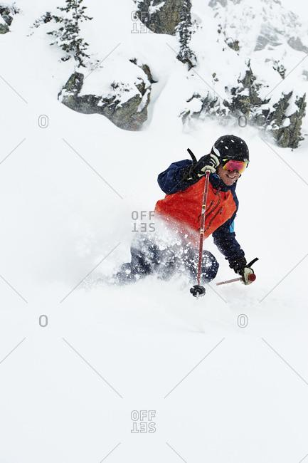 Skier skiing and splashing snow