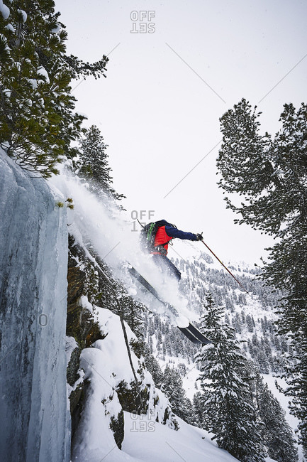 Skier skiing off slope, Kuhtai, Austria