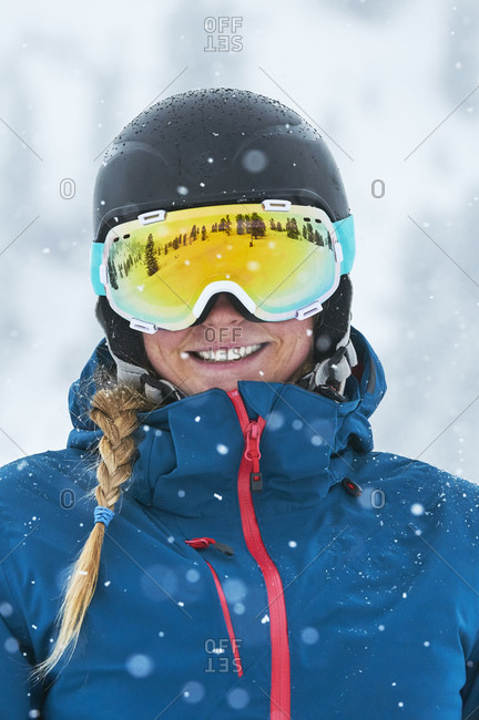 Portrait of female skier with goggles