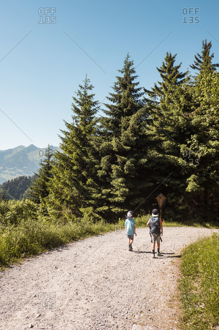 Boys hiking on trail, Bludenz, Vorarlberg, Austria