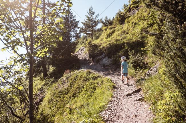 Boy hiking on trail, Bludenz, Vorarlberg, Austria