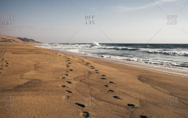 Footprints on sandy beach - Offset