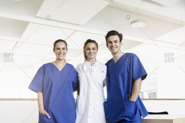 Happy doctor and nurses at corridor in hospital