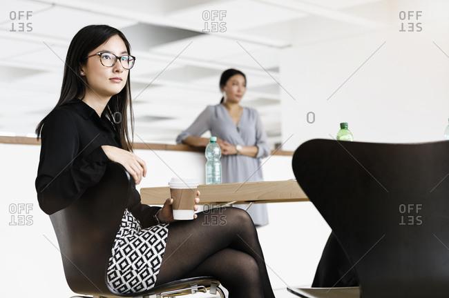 Businesswomen taking coffee break in office
