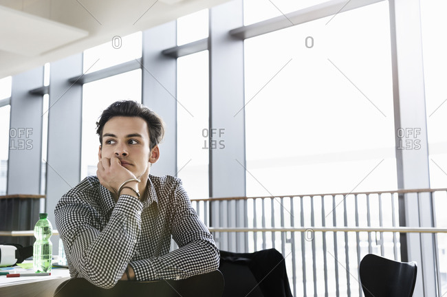 Businessman daydreaming in office