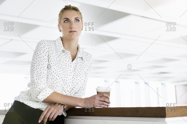 Businesswoman taking coffee break in office