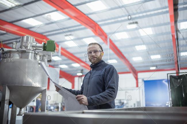 Portrait of engineer in metal fabrication factory.
