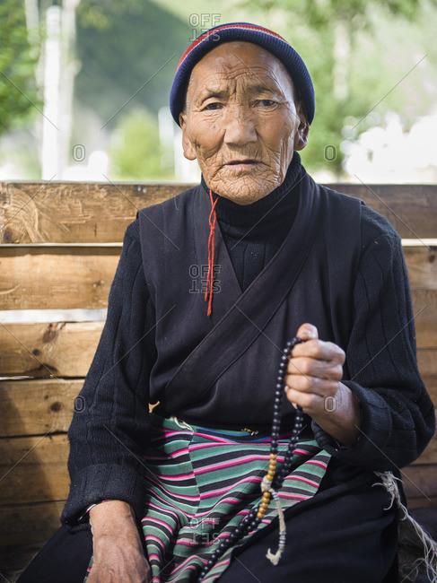 Old Tibetan woman praying, Tibetan plateau